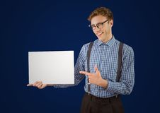 Nerd with blank card against navy background. Digital composite of Nerd with blank card against navy background Royalty Free Stock Photo