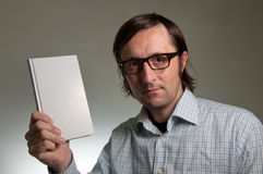 Nerd with a book Royalty Free Stock Photo