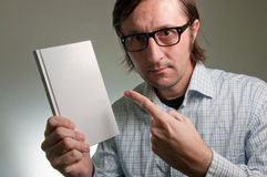 Nerd with a book Stock Images