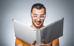 Nerd with book Stock Images