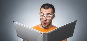 Nerd with book Stock Photography
