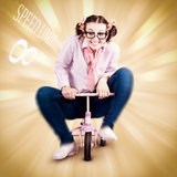 Nerd Breaking The Speed Of Sound On Kids Bicycle. Smart Science Woman Breaking The Speed Of Sound While Riding A Childrens Bike In A Funny Depiction Outsmarting Royalty Free Stock Photo