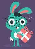 Nerd Bunny Holding un presente Fotografie Stock Libere da Diritti