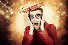 Nerd business man shouting out in fear of a bomb. Comic portrait of a nerd businessman shouting out in fear from a stick of explosive dynamite being launched Royalty Free Stock Photo