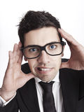 Nerd businessman. Funny portrait of a young businessman with a nerd glasses Stock Photography