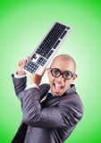 Nerd businessman with computer keyboard against Stock Photo