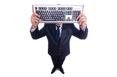 Nerd businessman with computer keyboard. On white Stock Photography