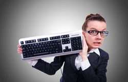 Nerd businessman with computer keyboard on white Royalty Free Stock Images