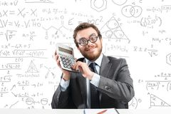 Nerd businessman. Concept of success with happy nerd businessman with calculator Stock Image
