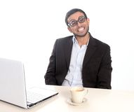 Nerd businessman in funny glasses working with computer royalty free stock images
