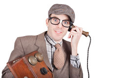 Nerd businessman on a funny phone communication. Isolated character portrait of a comic nerd businessman on a funny phone communication. Over white background Royalty Free Stock Photography