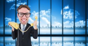 Nerd businessman holding telephone Stock Image