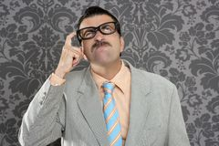 Nerd businessman pensive gesture silly funny retro Stock Photo