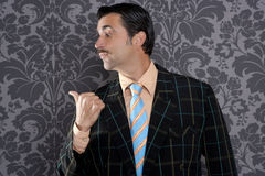 Nerd businessman portrait pointing thumb finger Stock Photo