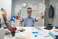 Nerd businessman thumbs up. Funny nerd businessman thumbs up at office with thick glasses Royalty Free Stock Photo