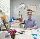 Nerd businessman thumbs up. Funny nerd businessman thumbs up at office with thick glasses Stock Photo