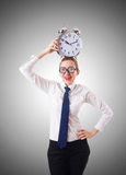 Nerd businesswoman with gian alarm clock Stock Photos