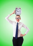 Nerd businesswoman with gian alarm clock Stock Image