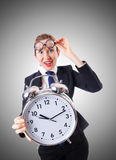 Nerd businesswoman with giant alarm clock Stock Image