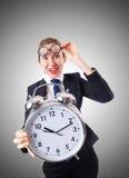 Nerd businesswoman with giant alarm clock Stock Image