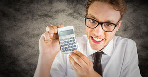 Nerd with calculator against brown grunge background Royalty Free Stock Photos