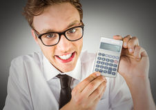 Nerd with calculator against grey background Royalty Free Stock Photo