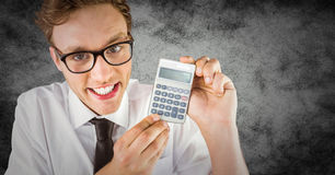Nerd with calculator against grunge background Stock Images