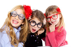 Nerd children girl group with funny glasses. Nerd children girl group with glasses and funny expression Stock Photo