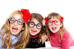 Nerd children girl group with funny glasses royalty free stock photography