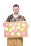 Nerd with corkboard Royalty Free Stock Photos