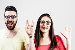Nerd couple doing the trekkie salutation Royalty Free Stock Image