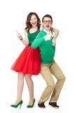 Nerd couple showing thumbs up. Interracial weird nerd couple showing OK sign. Caucasian young men wearing eyeglasses and smiling asian women showing thumbs up stock photo