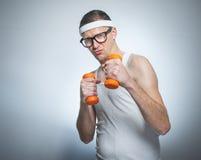Nerd with dumbbells exercising Stock Photos