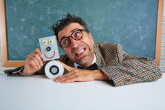 Nerd electronics technician with self made robot Royalty Free Stock Photography