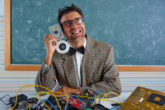 Nerd electronics technician silly hug a robot Stock Photography