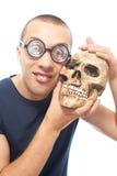 Nerd en schedel stock afbeeldingen