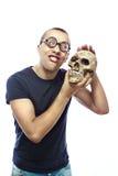 Nerd en schedel stock foto