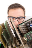Nerd engineer. Posing with computer components isolated in a white background Royalty Free Stock Images