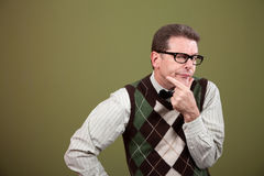 Nerd Expressing Doubt. Over green background stock photography