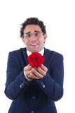 Nerd with expression holding flower Royalty Free Stock Photo