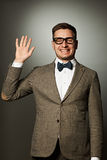 Nerd in eyeglasses and bow tie says Hello Royalty Free Stock Photos