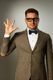 Nerd in eyeglasses and bow tie says Hello Stock Image