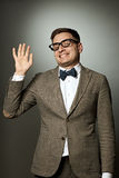 Nerd in eyeglasses and bow tie says Hello Royalty Free Stock Photo