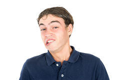 Nerd faces. Teenager nerd boy making faces isolated in white Royalty Free Stock Image