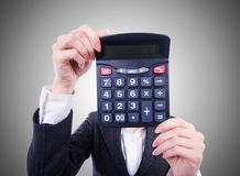Nerd female accountant with the calculator Stock Photo