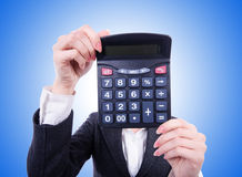 Nerd female accountant with calculator Stock Photo