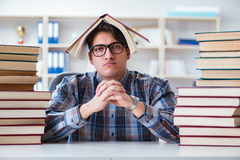 The nerd funny student preparing for university exams Royalty Free Stock Photography