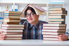 The nerd funny student preparing for university exams Stock Photo