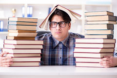 The nerd funny student preparing for university exams Royalty Free Stock Photos