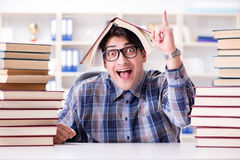 The nerd funny student preparing for university exams Royalty Free Stock Photo